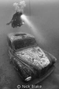 London Taxi Cab and diver, Wraysbury Lake, Middlesex by Nick Blake 